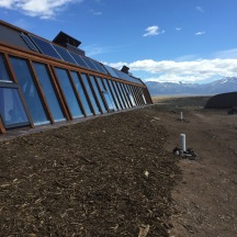 A finished earthship. Windows are slanted at 60' in order to maximise solar gain.